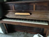 Piano upright , needs attention and collection