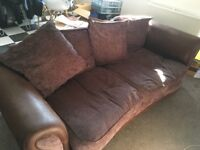 Matching brown 3 seater sofa and matching armchair