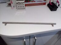 Kitchen T bar handles brushed stainless steel .