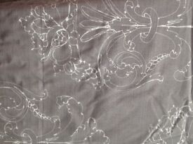 Two pairs of matching Light Grey pencil pleat Next Curtains with white flower pattern