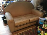 2 person leather sofa - camel coloured. Has been good friend!