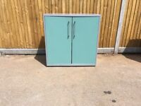 Metal 2 door filing cabinet with green doors