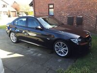 BMW 320i M Sports, DVD players in headrests