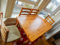 Rustic Pine Dining Table with Four Chairs