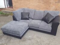 Stunning BRAND NEW black and grey cord corner sofa.small mark to the side. can deliver