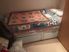 single bed with pretty headboard and two large draws below for storage