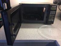 Panasonic microwave 1000watt black with spare glass turntable