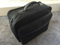 Samsonite black briefcase / computer case, multiple compartments. Good used condition, all zips work