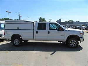2015 Ford F-350 Crew Cab 4x4 Diesel Long Box with custom Cap