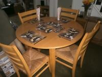 Light Beech dining table and 4 chairs.