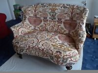 Pretty two-seater antique sofa