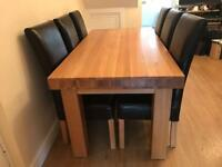 Solid oak dining room table, sideboard and wine rack