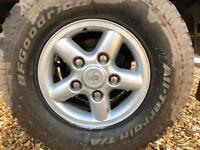 4 silver alloys and used All Terrain tyres for Defender