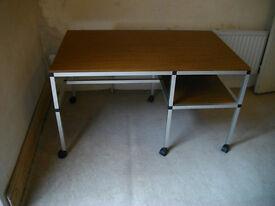 Desk with castor wheels