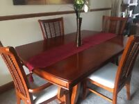 Burmese Teak Extending Dinning Table including 6 chairs