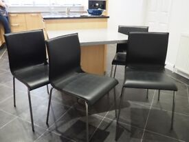 4 Black faux leather chairs