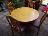 Table and four upholstered chairs, solid hardwood, very good condition