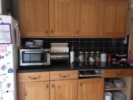 Wooden kitchen and black worktops