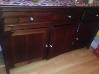 A very large solid wood dresse with 3 top draws