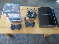 Sony PS3 with 2 controllers and 16 games