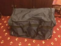 Large navy blue pull along holdall