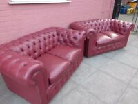 A Pair Of Salmon Reddish Leather Chesterfield Two seater sofas