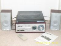 Bush RPA3 Turntable with CD player and AM/FM Radio. Remote control and user guide.