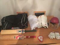 Junior cricket set - pads, helmet, 2 bats, hold all, gloves and box