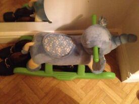 elephant rocking horse and teddy bear