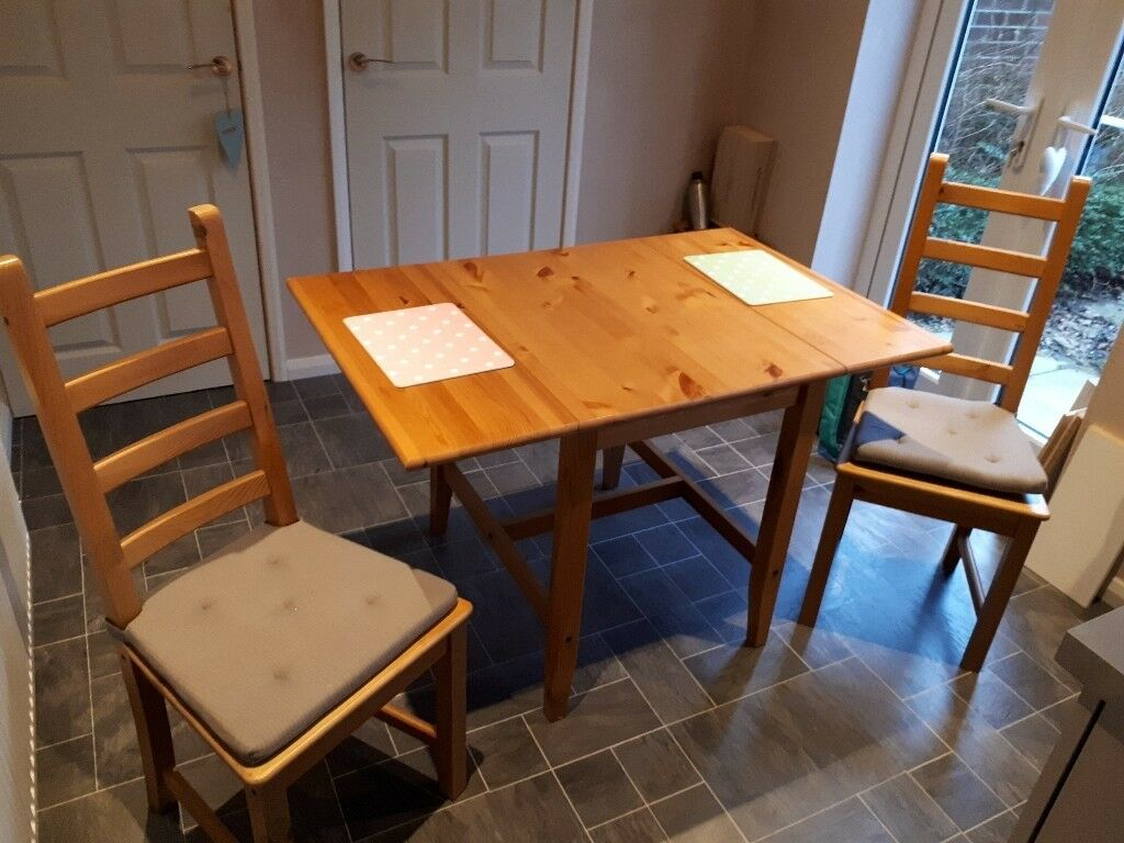 Solid wood bistro dining table and two dining chairs. Excellent condition.