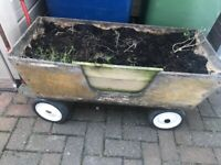 Wooden planter on wheels and handle