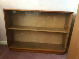 Wooden bookshelf with slidable glass front