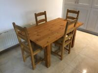Solid Pine Dining table and 4 chairs for sale