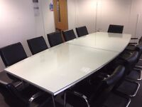 Glass Topped Boardroom Table & Leather Look Chairs. Very good condition.