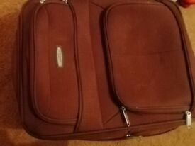 Small used travel suitcase