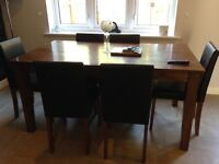 Wooden dining suite and 6 chairs