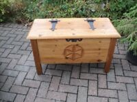large old wooden chest with lid in good order