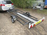 UNIQUE MOTORCYCLE TRANSPORTER ROAD TRAILER... MANUAL LOWERING BED..