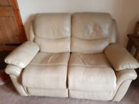 Reclining leather settee and matching reclining armchair