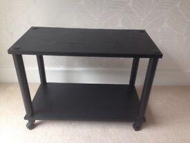 Black side table on castors