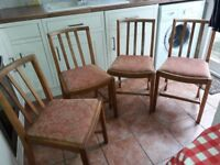 A set of 4 1950s oak utility dining/kitchen chairs