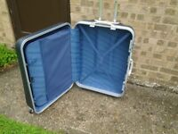 2 large Delsey 4 wheeled suitcases.