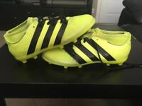 Yellow plastic studded boots size 5 Adidas