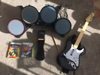 X Box 360 Guitar hero drum kit and guitar plus two discs