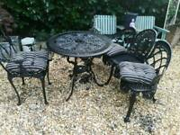 Cast iron table and chair and sofa