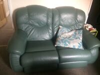 Green leather sofa with extended leg rest