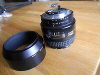 Nikon NIKOR AF 85mm f/1.8D with Hoya filter and lens hood