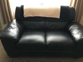 Two x 2 seater sofas black faux leather