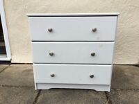 WHITE CHEST OF DRAWERS - UNUSED BUT KNOTS IN WOOD SHOWING THROUGH GIVING IT THE ANTIQUE LOOK
