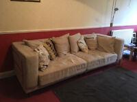 Two modern beige sofas